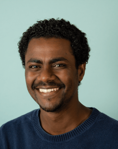 A photo of Adem Abebe smiling.
