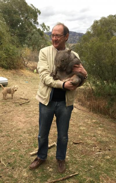 Bill Swaddling with a wombat