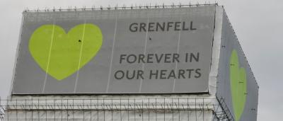 Top of Grenfell Tower with Banner