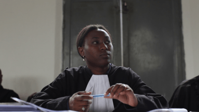 A photo of Amani Kahatwa, a Congolese lawyer, at the Minova trial. A still from The Prosecutors.