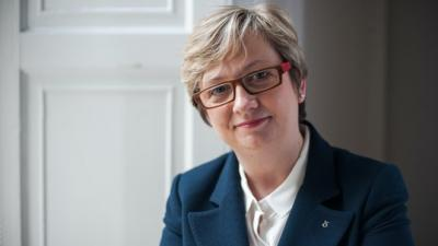 A photo of Joanna Cherry MP in a blue jacket, smiling.
