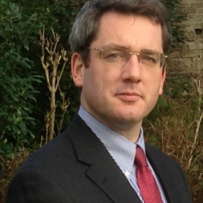 A photo of Nick Barber in a suit.