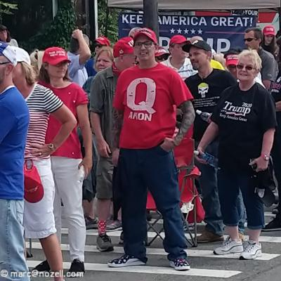 QAnon man in Red shirt.