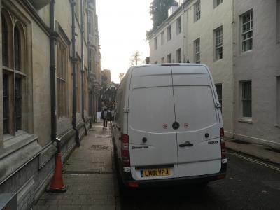 van leaving jesus college with books for renmin university