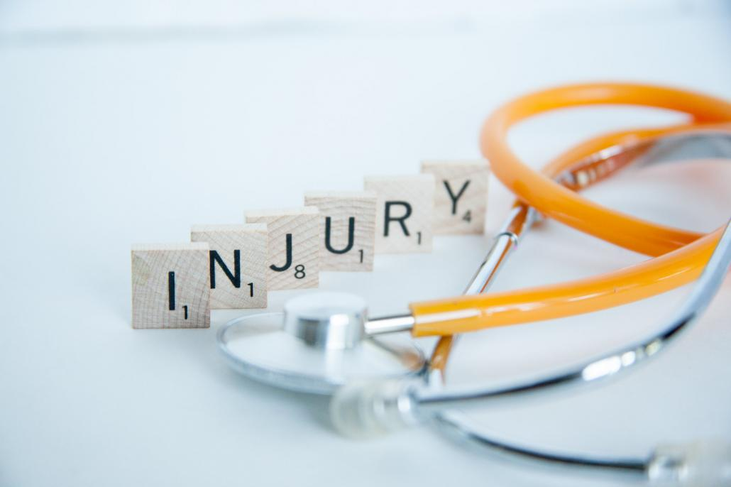 "Image of stethoscope next to the word ""Injury"""