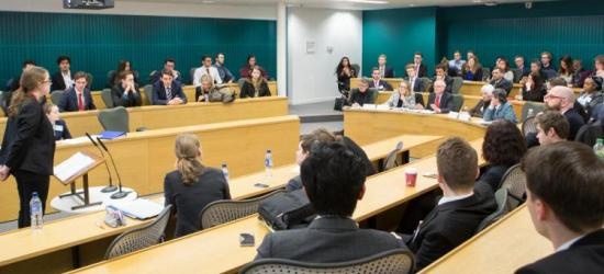 A picture of a past Oxford student speaking at the Grand Final of the moot.