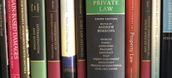 A bookshelf stocked with private law-related volumes