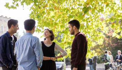 Graduate students in conversation outside