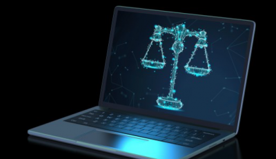 Image of Laptop with Law Scales